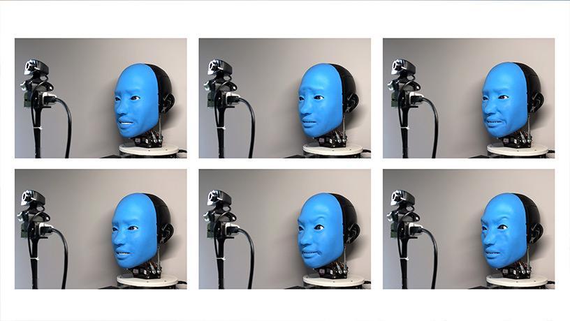 Robot practicing random facial expressions